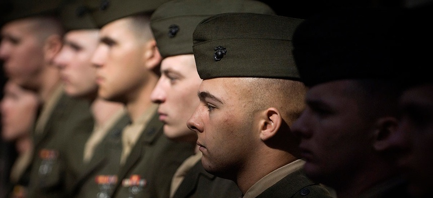 Marines stand at parade rest during a Navy Cross ceremony in 2009.