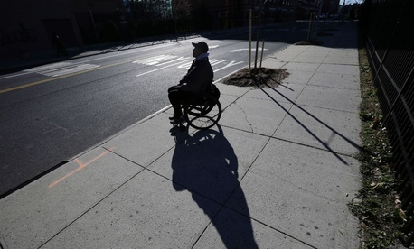 Paralyzed Army veteran Gene Laureano sits in his wheelchair Dec. 16, 2015, in Bronx, N.Y.