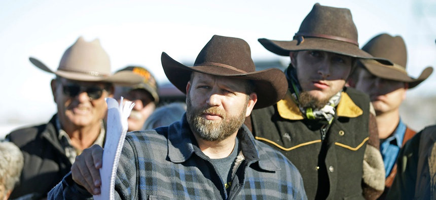 Ammon Bundy speaks with a reporter at a news conference at Malheur National Wildlife Refuge Friday.