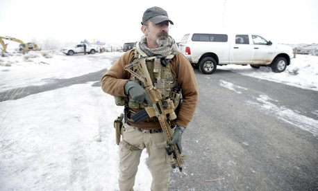 A man stands guard at the Malheur National Wildlife Refuge.