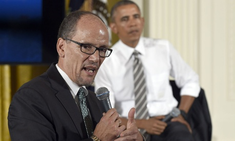 President Obama listens as Labor Secretary Thomas Perez speaks at the White House Oct. 7, 2015.
