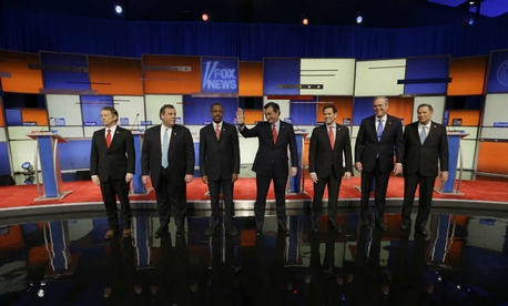 Presidential candidates Rand Paul, Chris Christie, Ben Carson, Ted Cruz, Marco Rubio, Jeb Bush and John Kasich appear before a Republican presidential primary debate, Thursday.