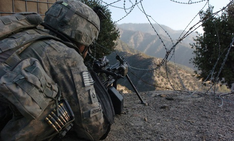 An Army soldier with Company B, 2nd Battalion, 12th Infantry Regiment, 4th Infantry Division, scans the Korengal Valley in Afghanistan.
