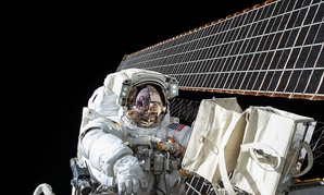 Scott Kelly conducts a spacewalk outside the International Space Station in November.