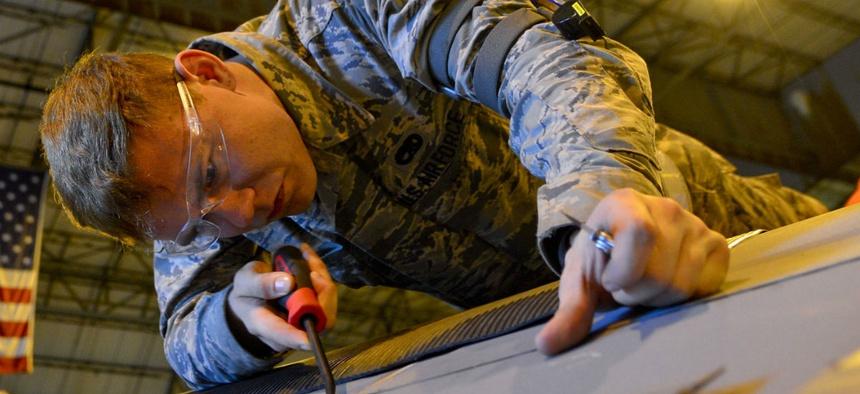 Airman 1st Class Jesse Gordon, a 436th Maintenance Squadron crew chief, works on an aircraft.