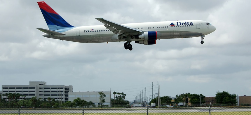 A flight lands at Miami International Airport.