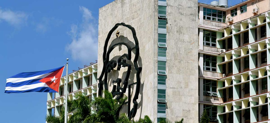 A Cuban flag flies near Che Guevara mural adjacent to Jose Martí plaza in Havana.