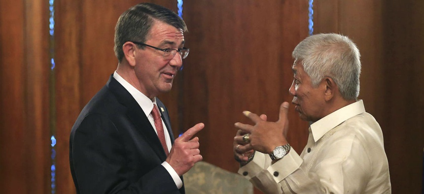 Defense Secretary Ash Carter speaks with his Philippine counterpart, Voltaire Gazmin, on Thursday.