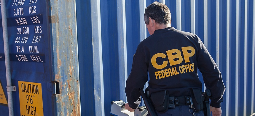 A CBP officer examines a shipping container at the Port of Newark in 2012.
