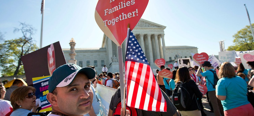 Mario Gochez joins protestors outside the Supreme Court Monday to rally for immigration reform.