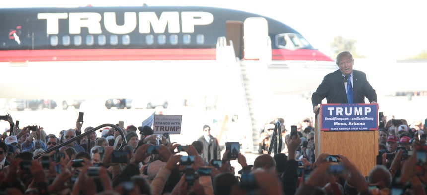 Trump speaks to supporters in Arizona in front of his jet in December.