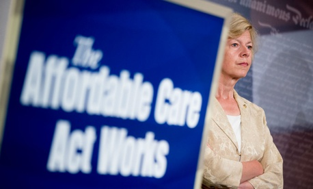 Sen. Tammy Baldwin, D-Wis., attends a press conference in July highlighting the positive aspects of the Affordable Care Act.