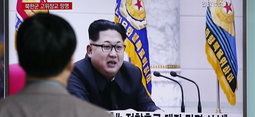 A man watches file footage of North Korean leader Kim Jong Un at Seoul Railway Station in Seoul, South Korea.