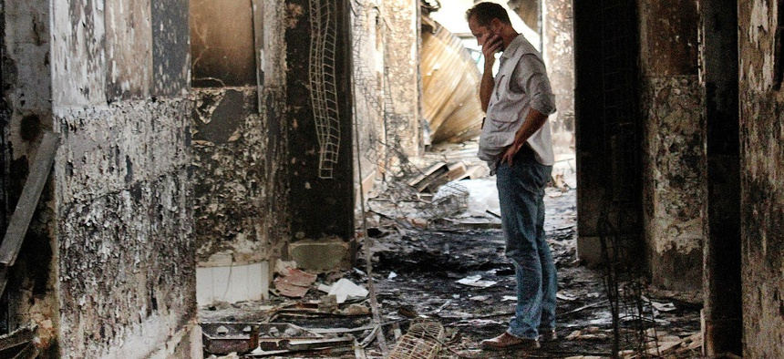 A Doctors Without Borders employee walks inside the remains of the organization's hospital after a U.S. airstrike in Kunduz, Afghanistan.