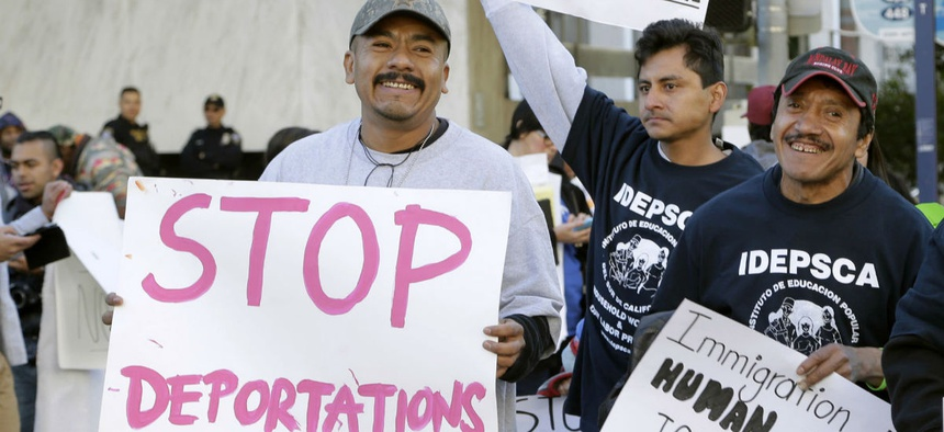 Immigration activists rally against ICE raids near the downtown Los Angeles Federal Building in January.