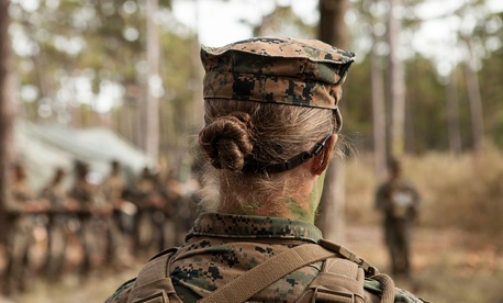 U.S. Marine Corps Private First Class Katie M. Gorz receives instruction during a training exercise in 2013.