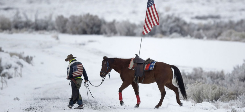 A supporter of the group occupying the Malheur National Wildlife Refuge earlier this year walks his horse near Burns, Ore. Attacks were on the rise even before the occupation.