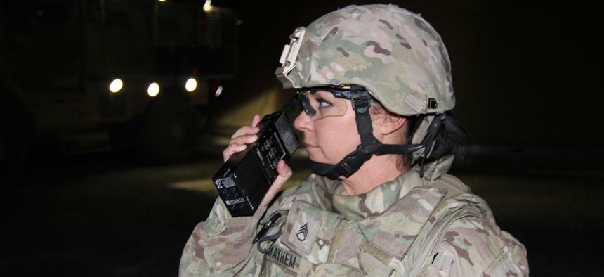 Staff Sgt. Shelda  Mairel directs communication in Kandahar in 2014.