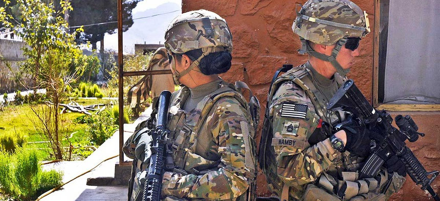 Army Pvt. 1st Class Jo Marie Rivera, left, a human resource specialist, and Sgt. 1st Class Rebecca Hamby, a military police officer, both with the 3rd Brigade Combat Team, maintain security in Afghanistan in 2013