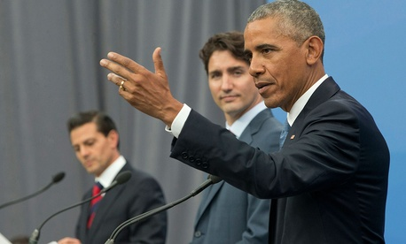 President Barack Obama, accompanied by Canadian Prime Minister Justin Trudeau and Mexican President Enrique Pena Neito, speaks during their trilateral news conference for the North America Leaders' Summit in Ottawa Wednesday.