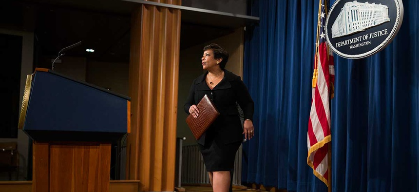 Loretta Lynch arrives at a Justice Department press conference in May.