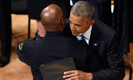 President Barack Obama hugs Dallas Police Chief David Brown after Brown introduced Obama to speak at an interfaith memorial service for the fallen police officers and members of the Dallas community.