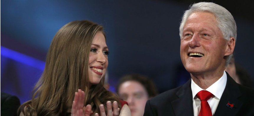 Chelsea Clinton and former President Bill Clinton listen to Hillary Clinton's speech at the Democratic National Convention.