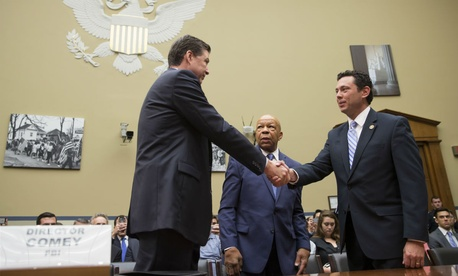 House Oversight committee chairman Rep. Jason Chaffetz, R-Utah, right, and ranking member Rep. Elijah Cummings, D-Md., center, welcome FBI Director James Comey on July 7.