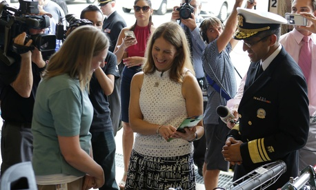 Kelly Deutsch, left, of Orange County Mosquito Control, talks with HHS Secretary Sylvia Burwell, center, and U.S. Surgeon General Vivek Murthy in Orlando about efforts to combat Zika.