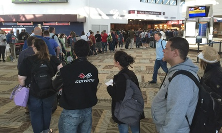 Hundreds of passengers wait in the TSA security line at Nashville International Airport April 18.