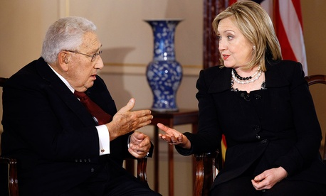 Former Secretary of State Henry Kissinger and Secretary of State Hillary Rodham Clinton talk during an interview by PBS' Charlie Rose in 2011.
