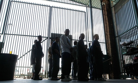 Persons are detained for being in the country illegally and are transferred out of the holding area after being processed at the Tucson Sector of the U.S. Customs and Border Protection headquarters in Tucson, Ariz. in 2012.