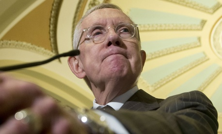 Senate Minority Leader Harry Reid said the government is headed for another shutdown unless lawmakers change course.