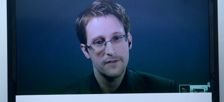 Edward Snowden speaks during a campaign calling for a pardon.