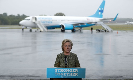 Hillary Clinton speaks with members of the media at Westchester County Airport on Monday.