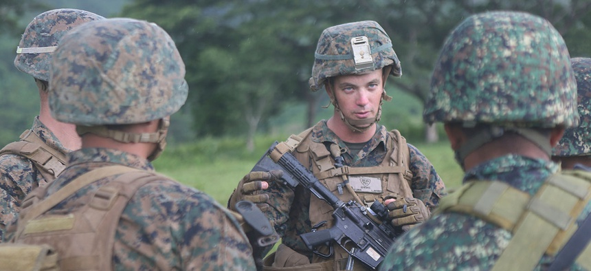 Marine Corps Capt. Kevin Jones, a San Antonio native, explains Marine Corps infantry tactics to members of the Philippine Marine Corps