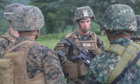 Marine Corps Capt. Kevin Jones, a San Antonio native, explains Marine Corps infantry tactics to members of the Philippine Marine Corps
