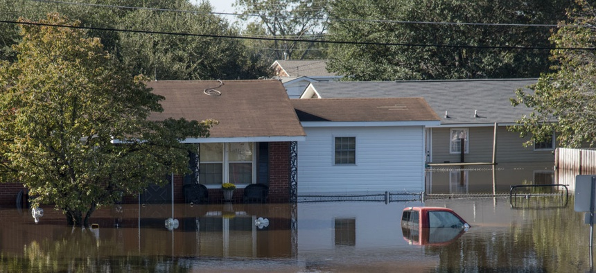 Flood waters surround a home in North Carolina, following rain from Hurricane Matthew.