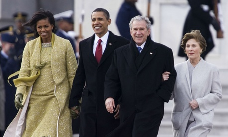 President Barack Obama and first lady Michelle Obama walk with former President George W. Bush and former first lady Laura Bush, as they leave the Capitol after the swearing-in ceremony Tuesday, Jan. 16, 2009.