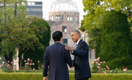 Barack Obama, right, bids farewell to Japanese Prime Minister Shinzo Abe as they take a closer look at the Atomic Bomb Dome after laying wreaths at the cenotaph for victims of the 1945 atomic bombing at Hiroshima Peace Memorial Park in September.