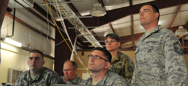 National Guard soldiers and airmen of the Blue Team listen to their team leader Cyber Shield 2016 at Camp Atterbury, Ind. April 20, 2016.
