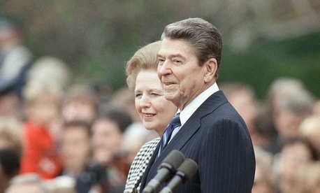 Margaret Thatcher and Ronald Reagan walk in Washington in 1988.