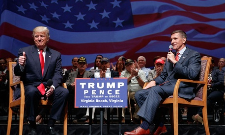 Republican presidential candidate Donald Trump gives a thumbs up as he speaks with retired Lt. Gen. Michael Flynn during a town hall in September.