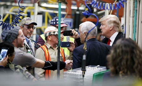 President-elect Donald Trump and Vice President-elect Mike Pence talk with workers during a visit to the Carrier factory in Indianapolis on Dec. 1.