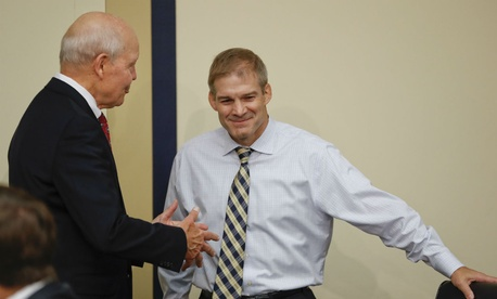 IRS chief John Koskinen (left) speaks with Rep. Jim Jordan, R-Ohio, before a September hearing on Koskinen's impeachment.