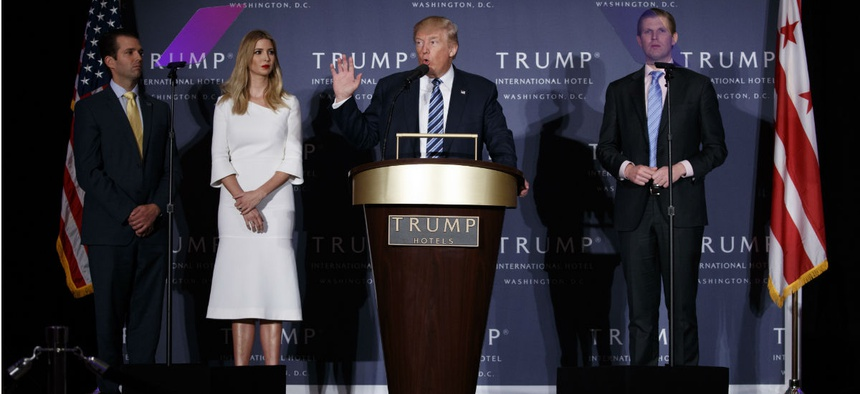 Trump's sons Donald Trump Jr. (left) and Eric Trump (right) accompany him at the grand opening of the Trump International Hotel in Washington.