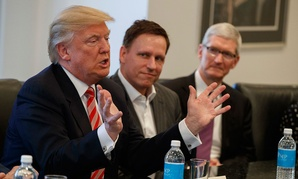 Apple CEO Tim Cook, right, and PayPal founder Peter Thiel, center, listen as President-elect Donald Trump speaks last week.