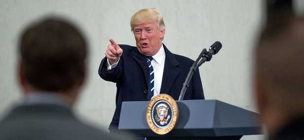 President Donald Trump points to a member of the audience after speaking at the Central Intelligence Agency Saturday.