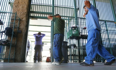 Suspected illegal immigrants are transferred out of the holding area after being processed at the Tucson Sector of the U.S. Customs and Border Protection.