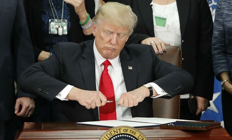 Trump signs executive orders on immigration Wednesday.